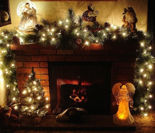 Carolers Displayed On A Mantle With Garland And Stockings: Christmas Ideas: Christmas Fireplace Decoration, Xmas