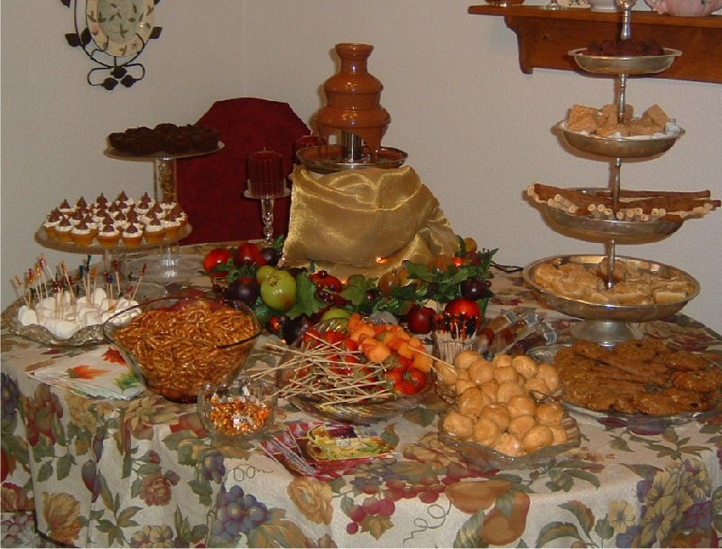 For the dessert table I set up my chocolate fountain. I baked mini pumpkin muffins with frosting and added a carmel kiss on top. We also made fruit skewers ... & Fall themed party table | Life and Linda