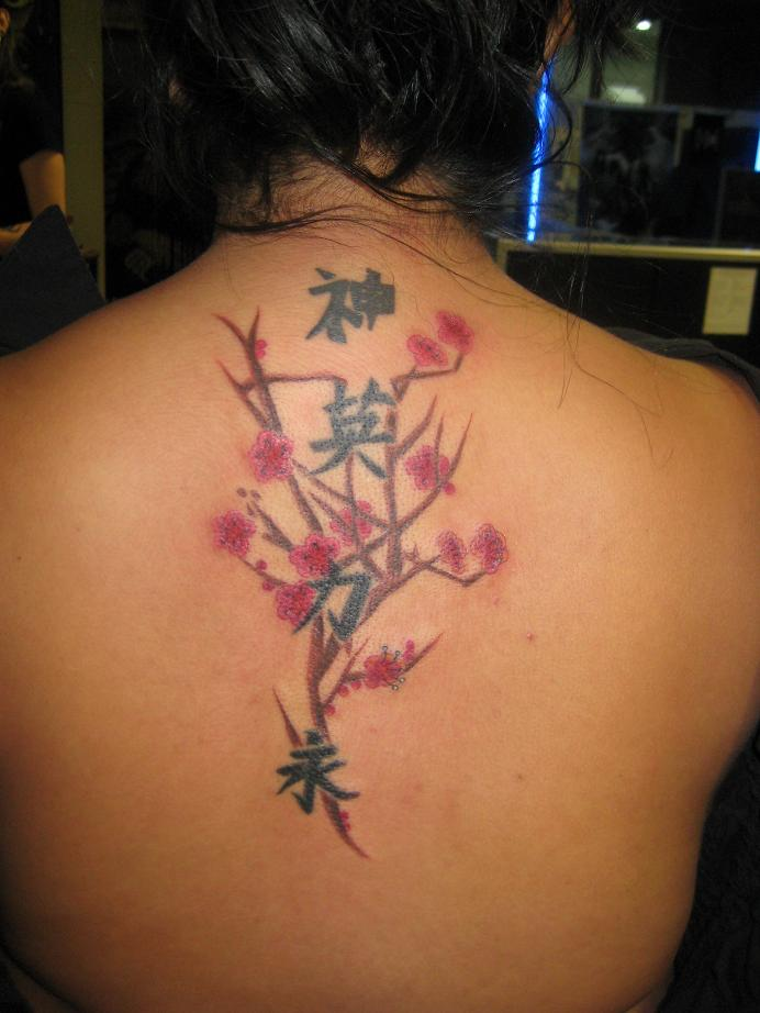 Japanese  Character Tattoo and beautiful flower on the back