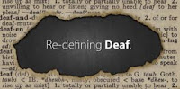 "Sign reading ""Re-defining Deaf"""