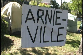 ArnieVille sign in front of tents
