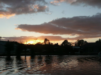 An end to a perfect day as the sun sets over the River Bure at Wroxham