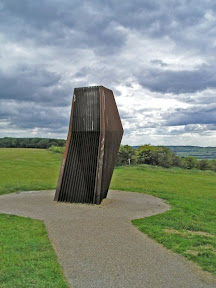 On the left, the meeting point of the Ridgeway and the Icknield Way at the foot if Ivinghoe Beacon; On the right, the Windcatcher, the air intake for the Dunstable Down Visitor Centre heating system