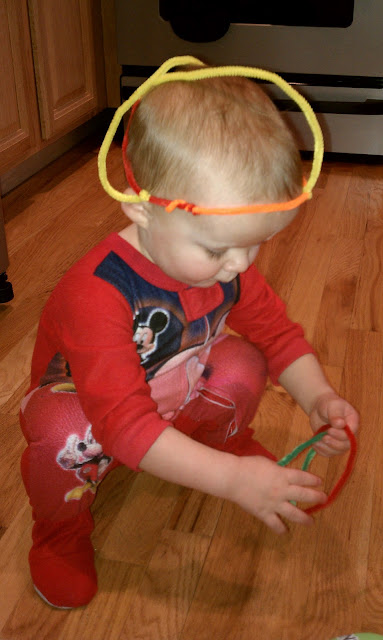 JD playing with pipe cleaners.
