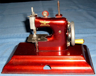 Toy Sewing Machines Sold Casige Red Metallic Toy Sewing