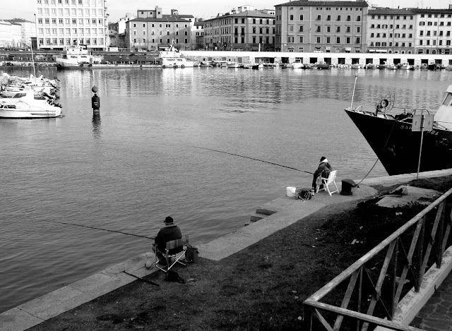Fishing in the new harbor, port of Livorno