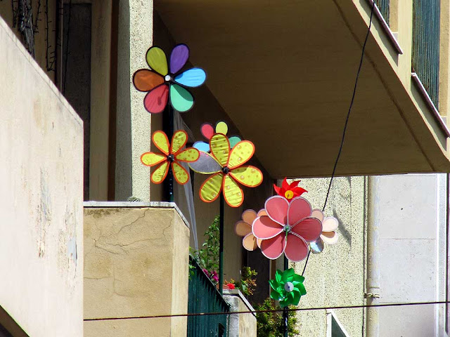 "Balcony with wind wheels and spinners, via Cambini, Livorno"" is all for"
