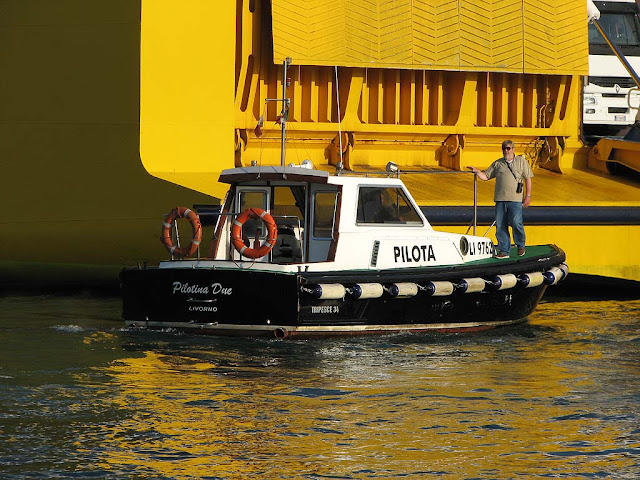 Pilot boarding a ferry from a pilot boat, Livorno