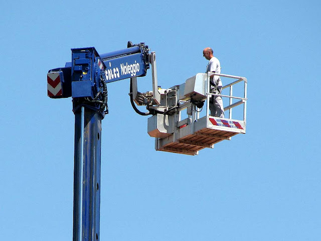 Cherry picker, boom lift at work, Livorno
