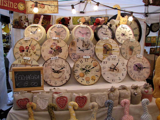 Funny clocks, food market, Livorno
