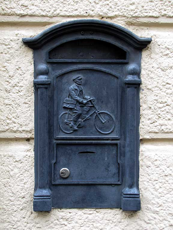 Mailbox with mailmanon a bike, Livorno