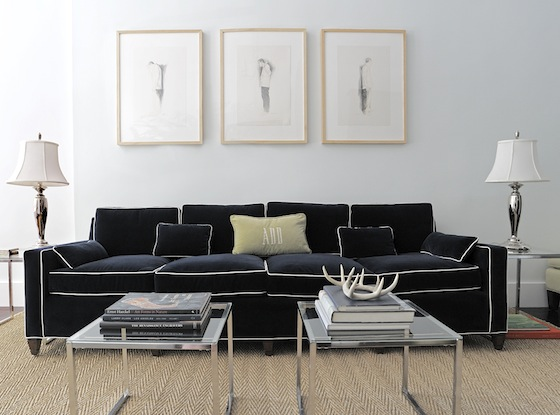 Living room with navy sofa with white piping