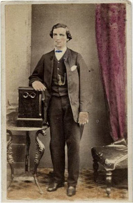 Nevin's carte of young man with stereo viewer