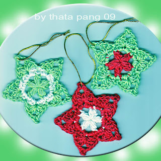 crocheted star with a flower