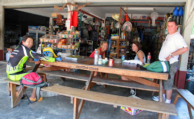 Drinks at the local shop in Koh Yao Noi (my can of Coke, center of table)