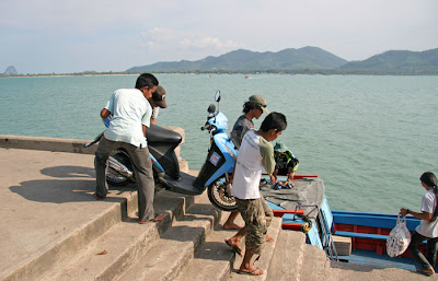 Loading a moped onto the ferry at Koh Yao Noi