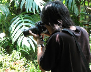 Photographer at Phuket Butterfly Garden