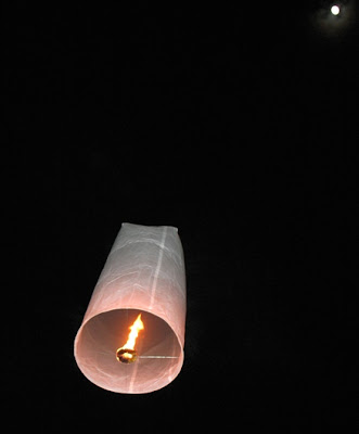 Kom Fai Lantern heading towards the full moon