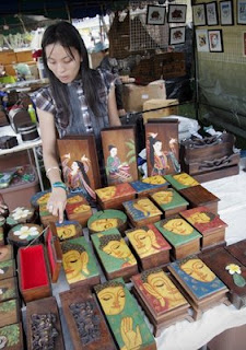 Painted Buddha boxes at the OTOP Fair Phuket