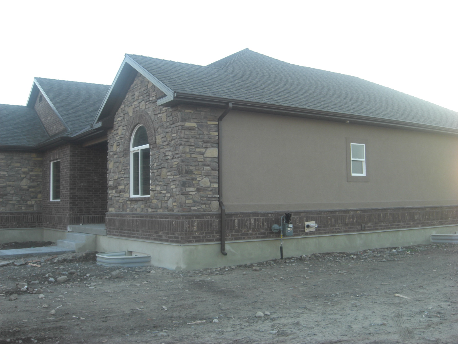 The Stucco Is Spectrum Brown And 150 On Trim Soffits Fascia Gutters Are Musket