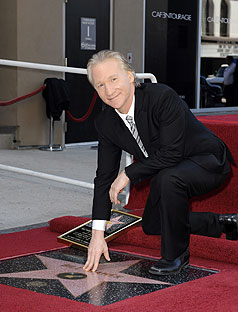 Bill Maher poses with Hollywood walk of fame star which will soon be most pissed on spot in America