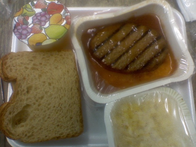 Salisbury steak, bread, corn, milk, pineapple chunks