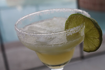glass with margarita and salted rim and lime slice