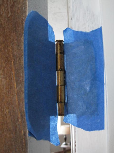 painters tape on door hinge