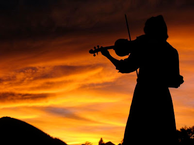 Violin at sunset by Jamie Marie