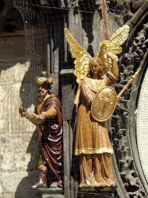 chronicler and angel of Astronomical Clock in Prague