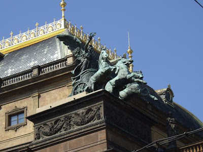chariot with horses statue on roof in Prague