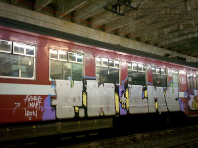 train graffiti of Pw, LMC, Aigrie, Inapt and Leon
