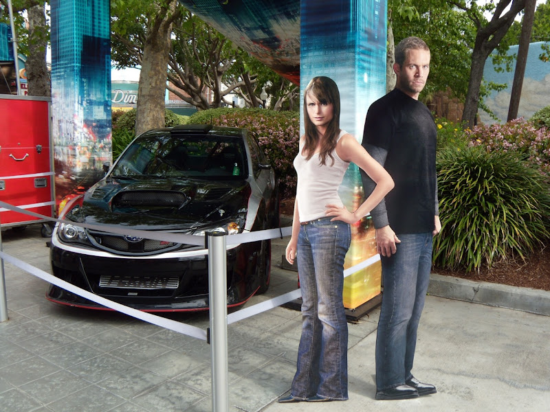 Fast & Furious stars Jordanna Brewster and Paul Walker and car