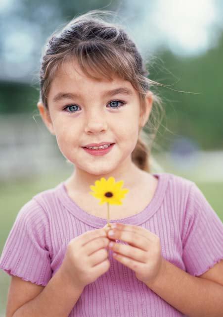 modelling peace between NAMC montessori teachers parents classroom girl with flower