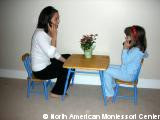importance NAMC montessori practical life activities classroom talking on phone