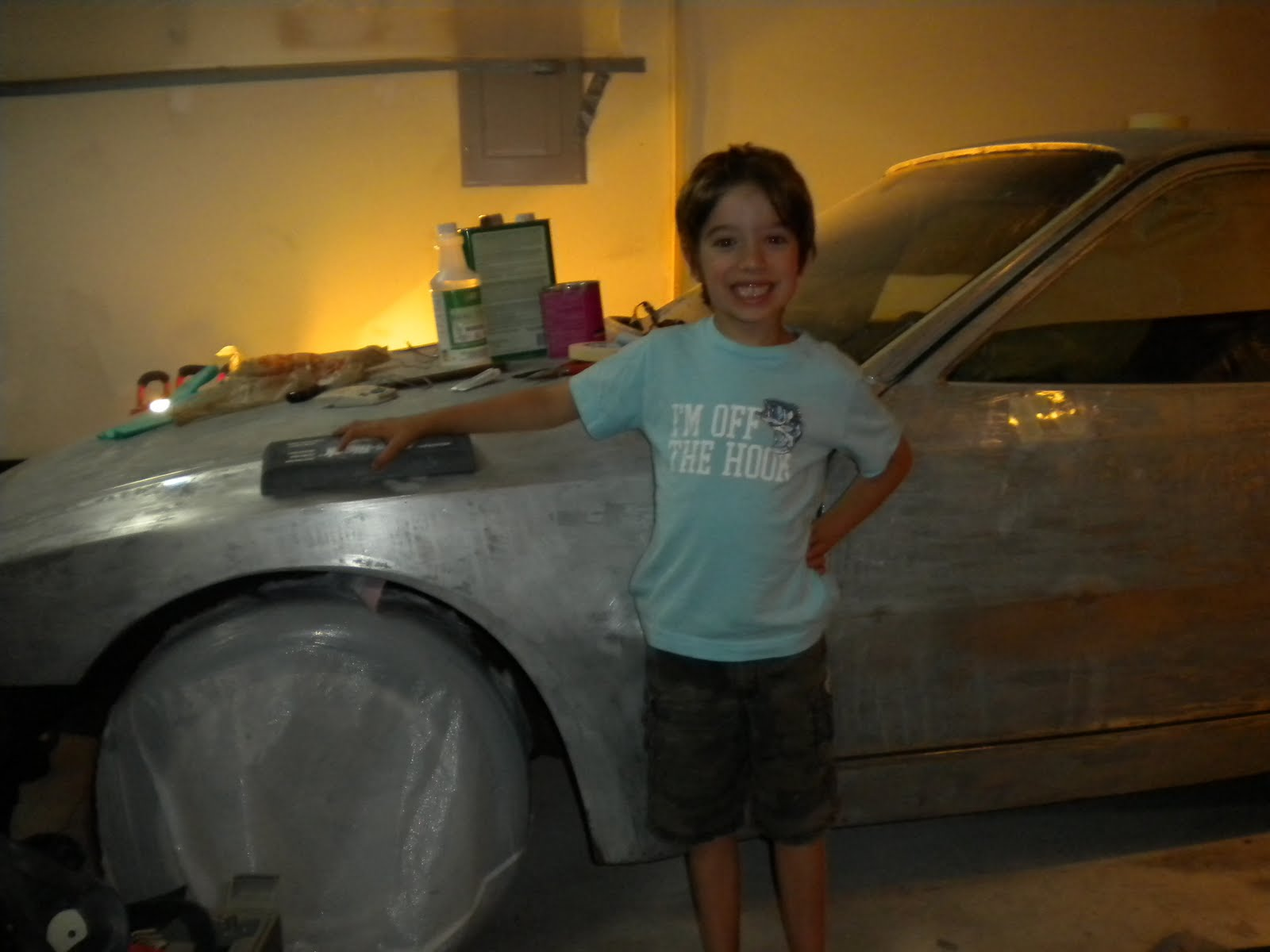 Repainting My 1983 Porsche 944: More Bondo and my son helps