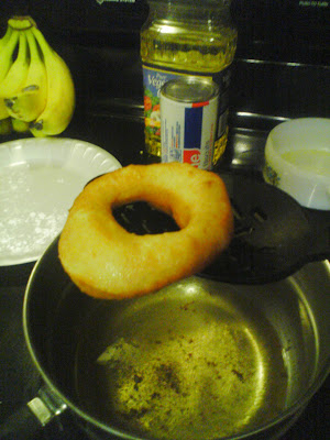 making fried doughnuts frying donuts