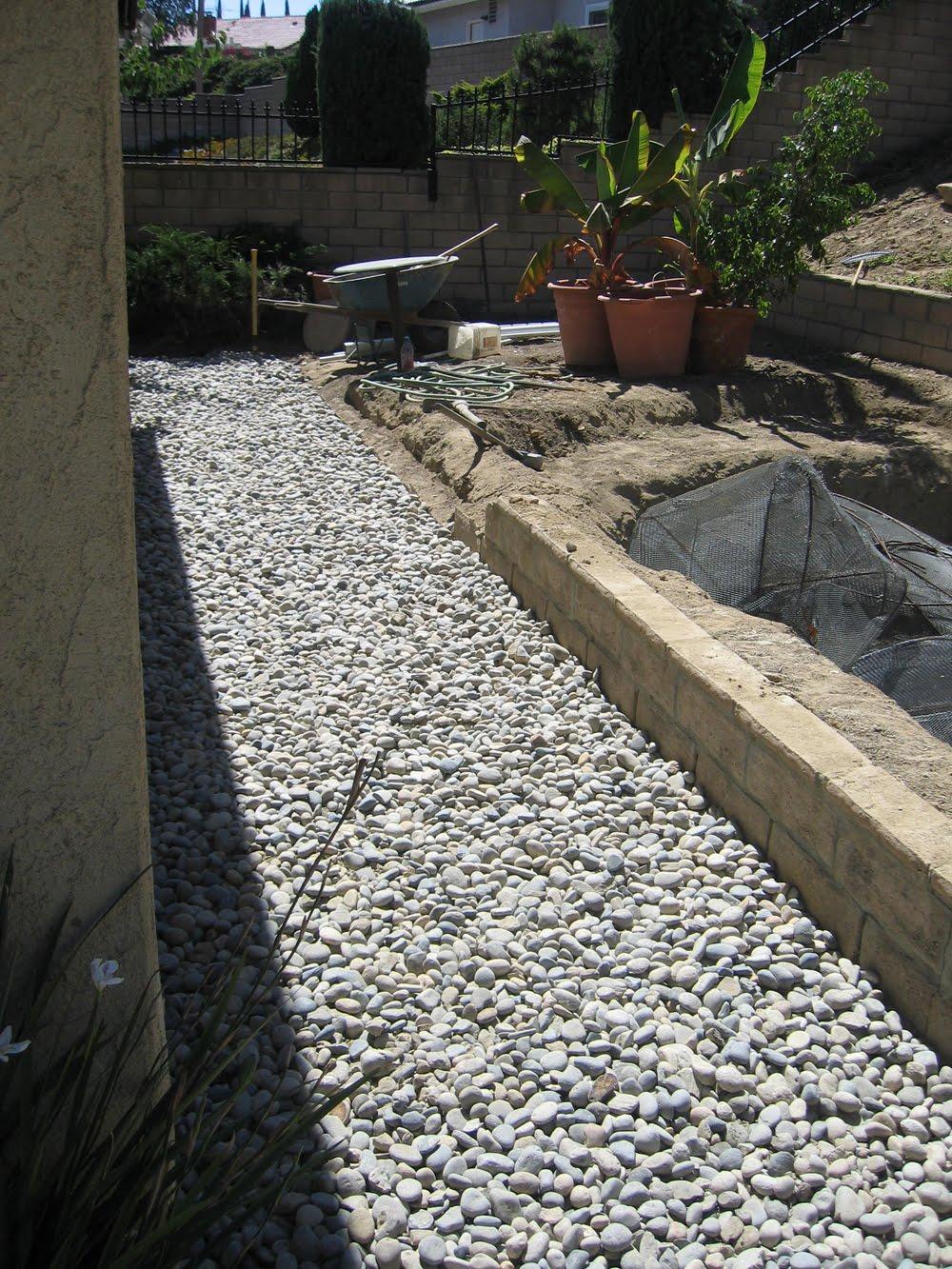 Japanese Garden Koi Pond: River rock walkway installation