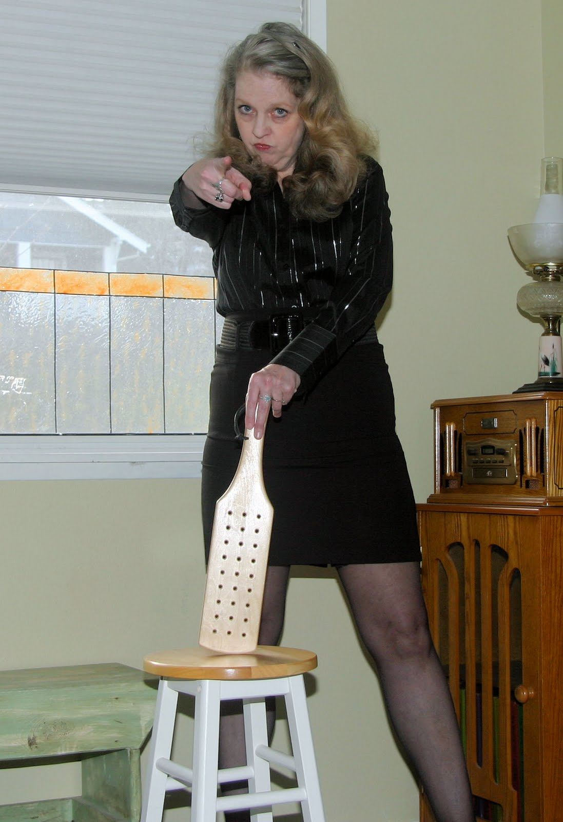 Spank with a paddle