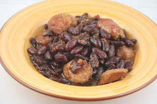 How to make Boston Baked Beans in the crockpot slow cooker. Brown sugar, kidney beans, onions, sausage, molasses -- great for a backyard party side dish.