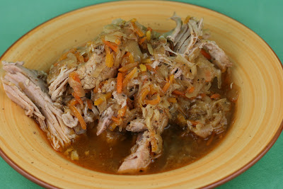 Pulled Pork with Sauerkraut -- this is a fun, tangy twist on traditional pulled pork. If you like sauerkraut, you've got to try this!