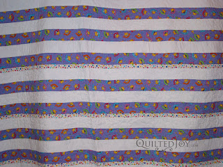 """Pieced back with 2"""" wide strips all perfectly square! - QuiltedJoy.com"""