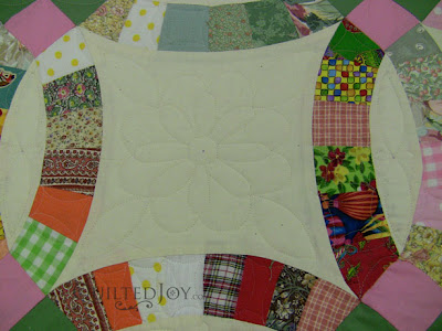 Scrappy Double Wedding Right quilt on the APQS Millie Frame - QuiltedJoy.com