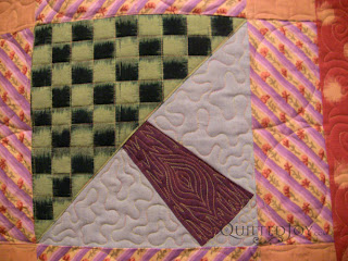 Fassett in the Forest Quilt with custom quilting by Angela Huffman- QuiltedJoy.com