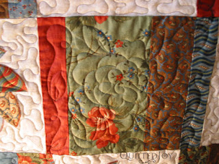 Freehand cabbage rose in the rectangles by Angela Huffman - QuiltedJoy.com