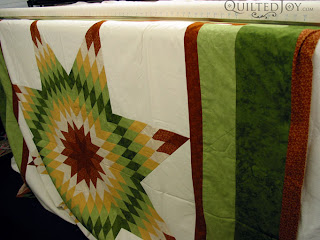 Kathy's impressively flat lone star on the frame - QuiltedJoy.com