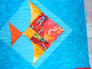 baby quilt with freehand water meander and trapunto effect