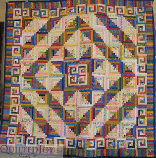 Debbie's Log Cabin quilt - phenomenal colors and patterns!
