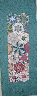 Stack & Whack Table Runner, quilted by Angela Huffman