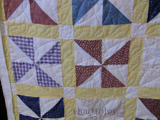Katy's Pinwheel Party, quilted by Angela Huffman